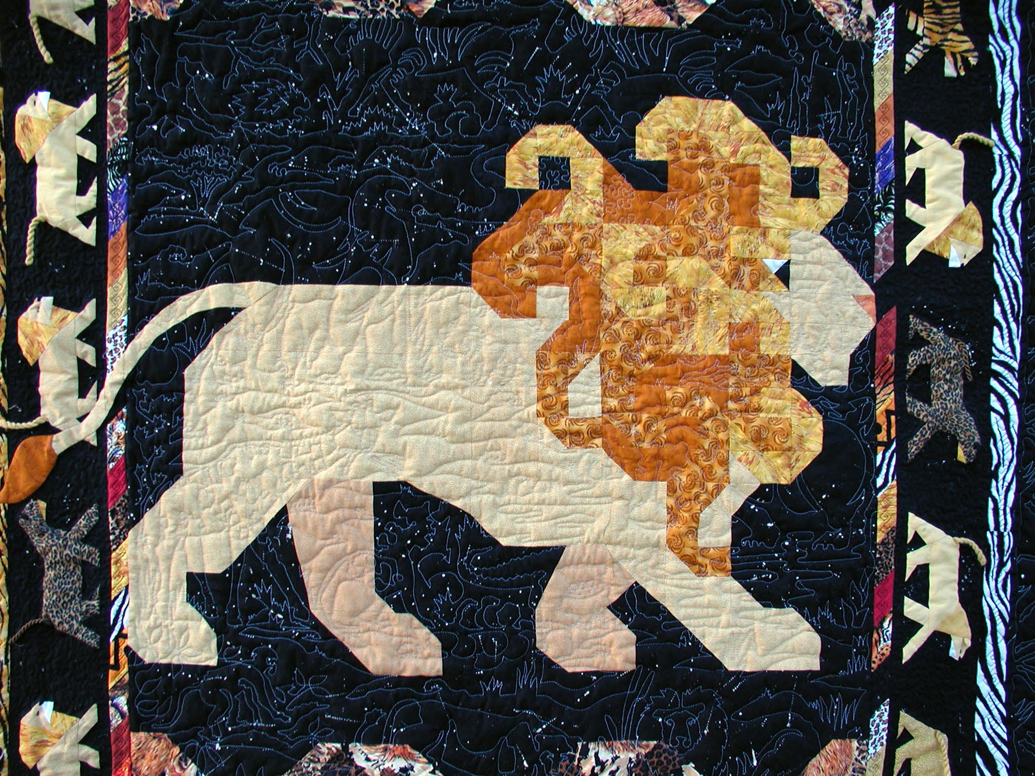 Safari Night closeup showing Safari 11″  by Judy Lyon quilted by Pat Brown